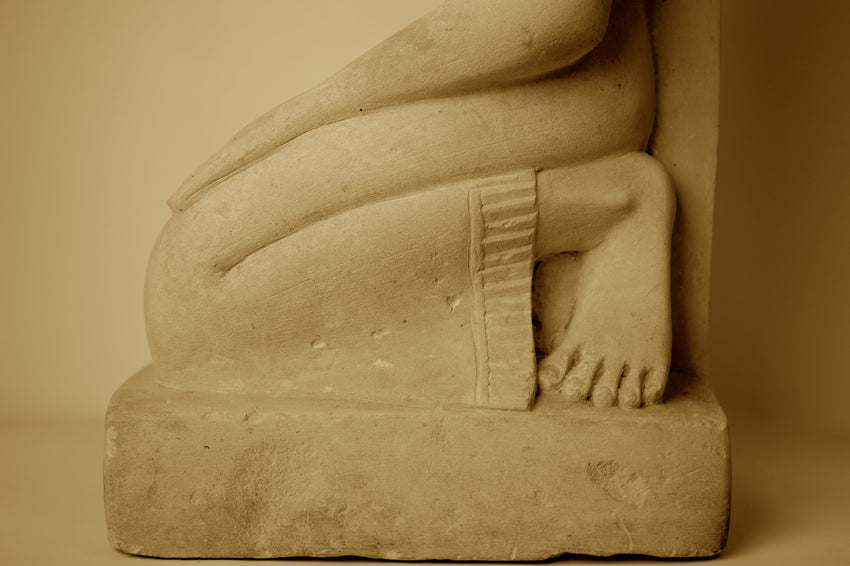 EGYPTIAN LIMESTONE STATUE OF A KNEELING LADY IN PRAYER