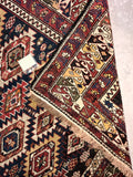Colorful geometric tribal looking Russian Caucasian Shirvan rug