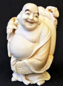 A Japanese ivory okimono of Hotei (the God of Happiness), late Meiji period