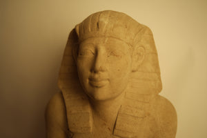 EGYPTIAN LIMESTONE STATUE OF A KNEELING PHARAOH