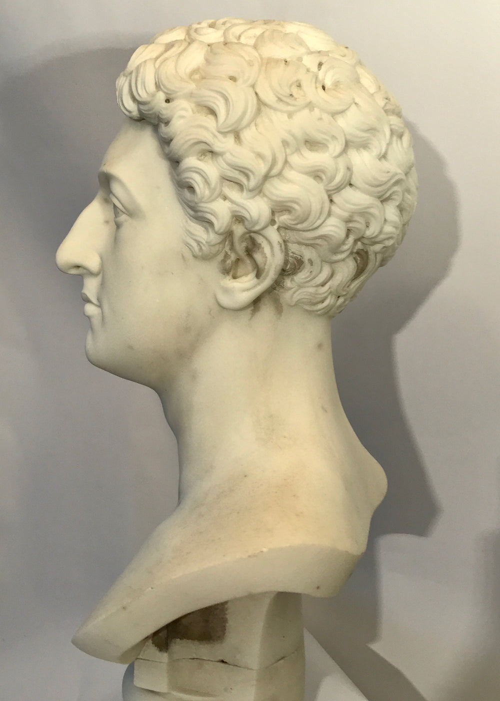 19th century White marble bust of a Gentleman, on a white marble socle