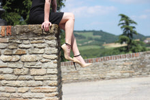 Shoes modeled atop Benevelo in the square of the Castello, overlooking the Piedmont hills.