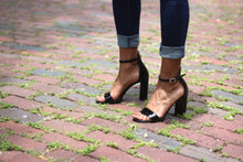 Black Saffiano Patent Leather Ankle Strap Sandal (90mm) Modeled on antique brick streets in Houston, Texas.