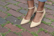 Nude Napa Leather Ankle Strap Mid Heel (70mm) modeled on antique brick streets in Houston, Texas.