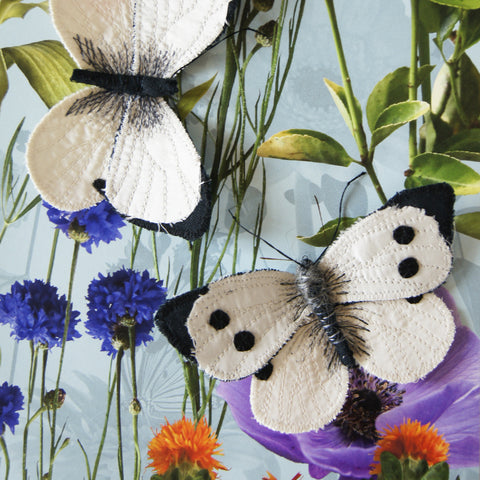 two pieris brassicae butterflies, female and male, made from black linen and white satin