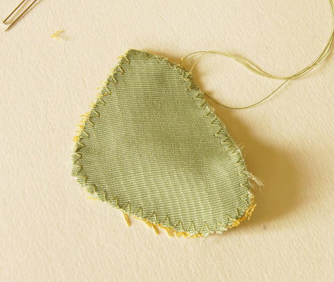 one underwing and backing piece stitched together around the edges with a zigzag stitch