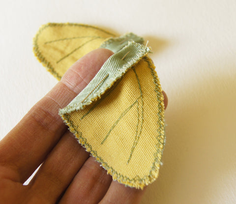 close up of one underwing, folded and pinned