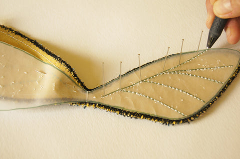 paper pattern pinned to other wing, 6 pins directly in top vein, into fabric, vertical and frixion pen used to mark dots at pin pricks