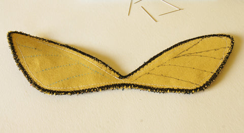 both upper wings with their vein marking finished