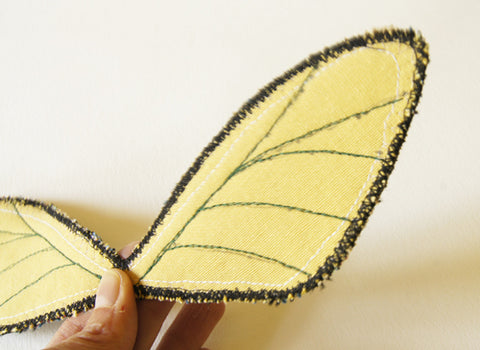 veins stitched on back of wings