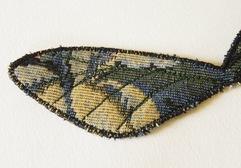 finished upper wings with veins sewn in green machine embroidery thread, forest green
