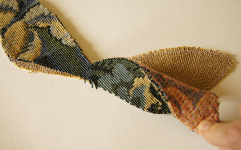mainn tapestry fabric placed face up on the burlap