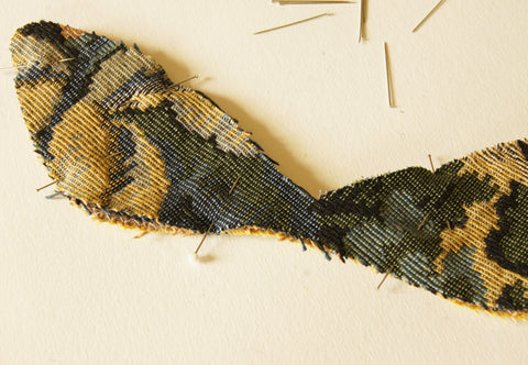 pin around edges of the three layers: main fabric, burlap and backing