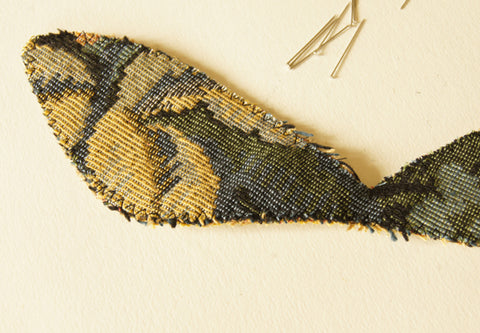Three layers of wing fabrics stitched together around the edges with long and wide zigzag stitch