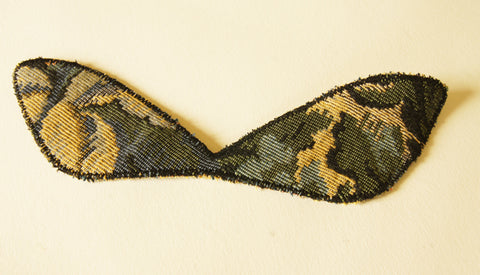 upper wings stitched three times around with a wide zigzag stitch to creat a bold graphic outline