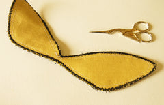 the back of the moth wings, a solid yellow fabric
