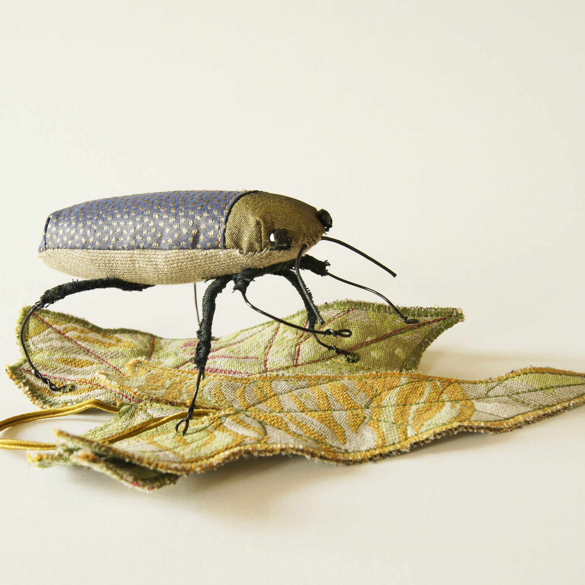 Jewel Beetle textile sculpture with textile leaf