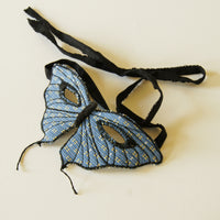 Tailed butterfly mask in blue upholstery fabric