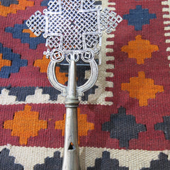 Ethiopian standing cross on an Afghan kelim