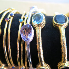 Gold plated bangles glittering with semi-precious stones
