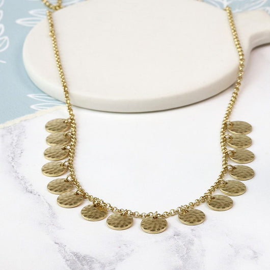 Gold coloured disc necklace