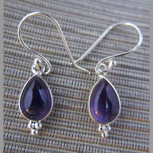 Sterling silver and amethyst drop earrings.