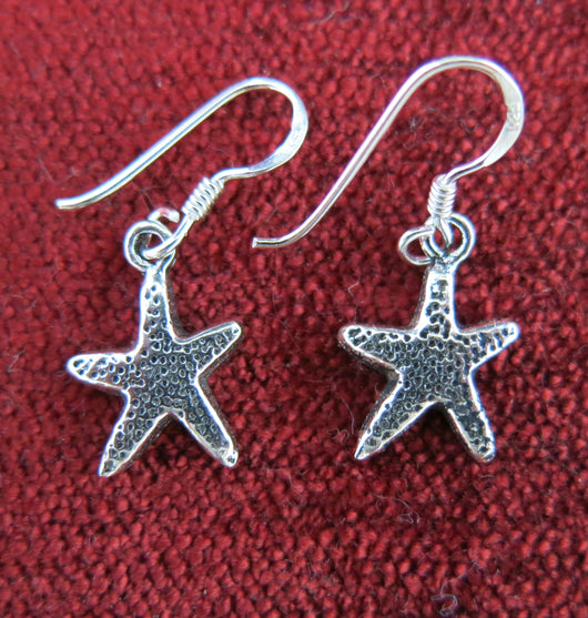 Small silver starfish drop earrings