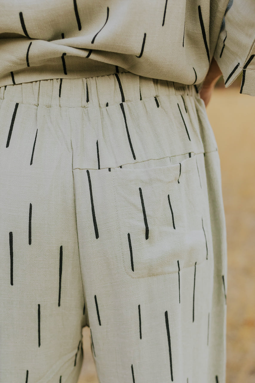 Light grey green line print pants | ROOLEE