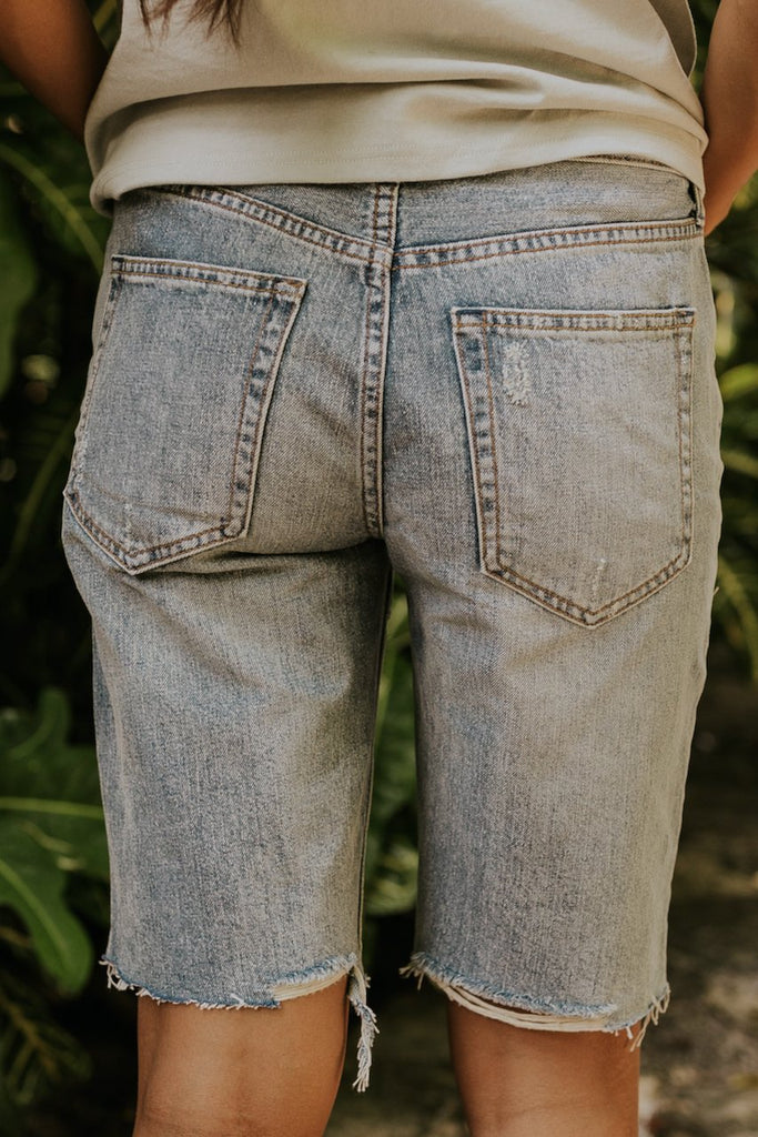 Knee length distressed denim shorts | ROOLEE