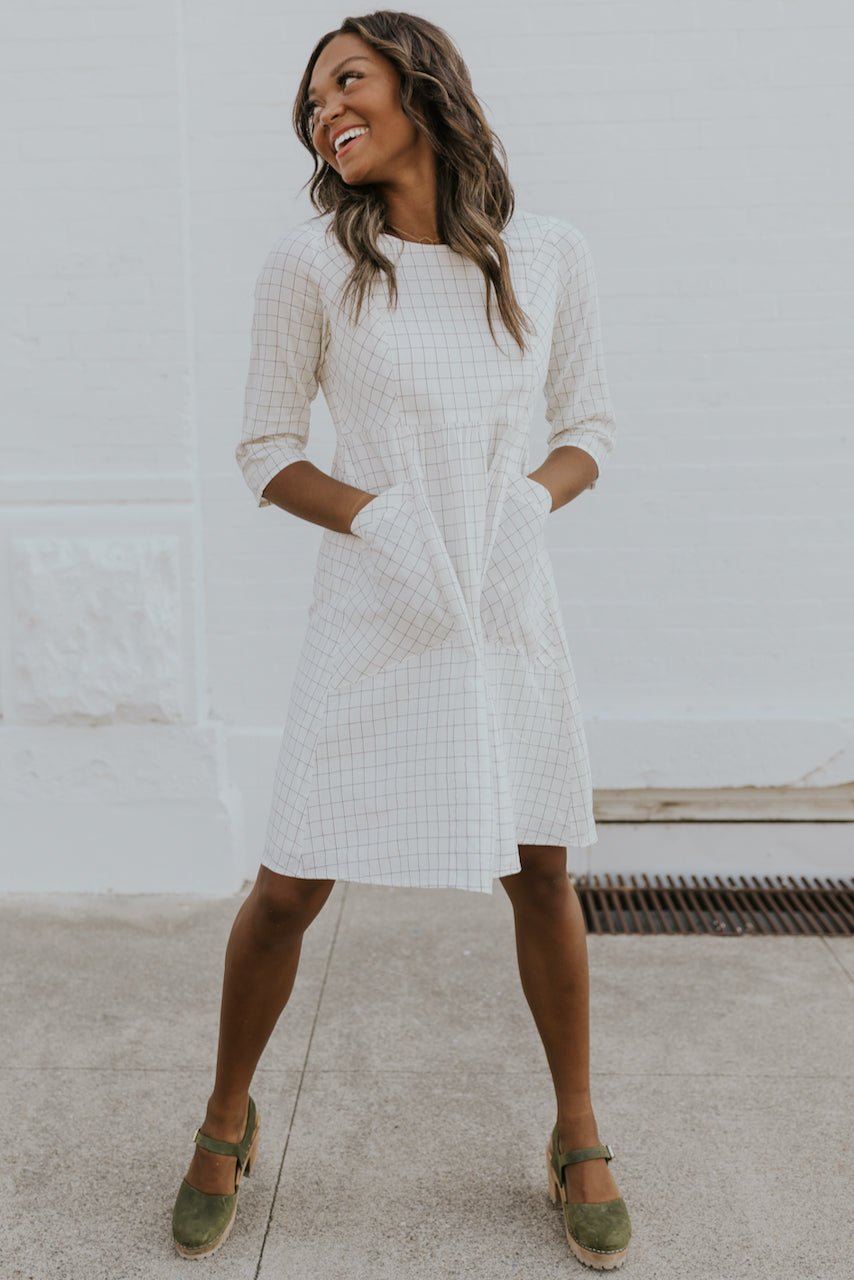 Knee length grid dress for fall in white | ROOLEE