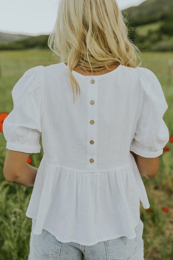 Button back dainty babydoll blouse | ROOLEE