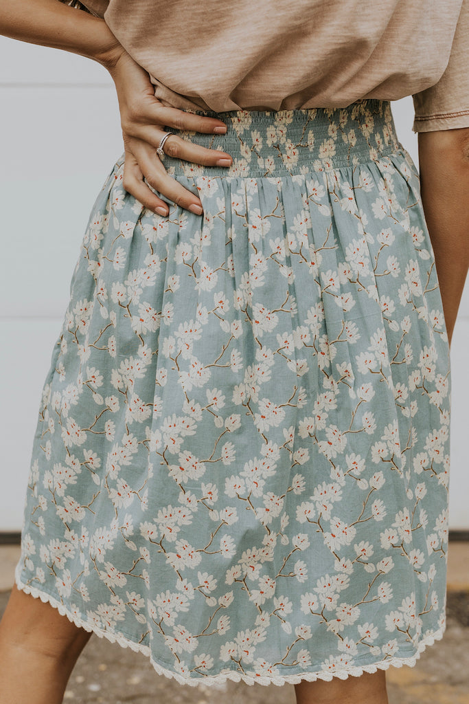 Vintage blue knee length floral skirt | ROOLEE
