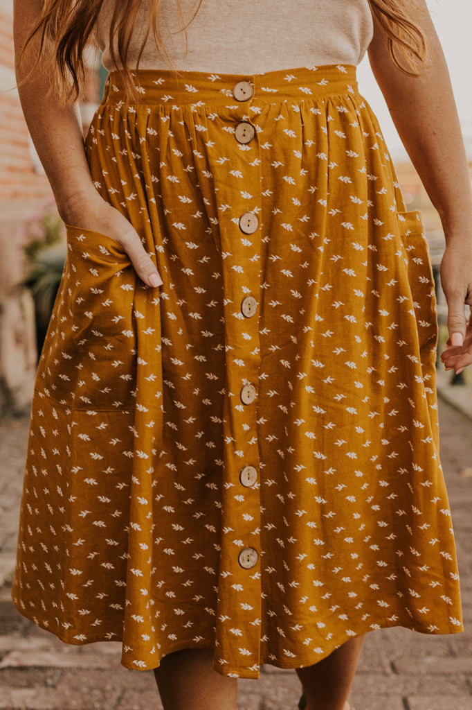 Mustard Fall Abstract Print Button Skirt | ROOLEE