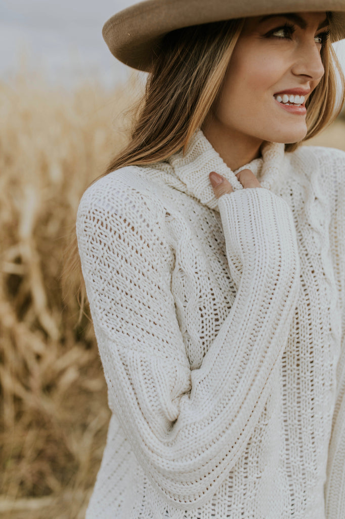 Cable Knit Turtleneck Sweater in Cream | ROOLEE