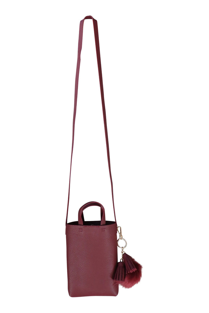 Pounding Pavement Mini Crossbody Bag in Wine