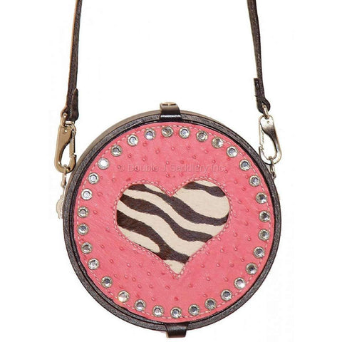 Pink ostrich goat string can with zebra cowhide inlays and pink crystals.