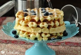 Stack of gluten free waffles made using gfJules gluten free pancake mix