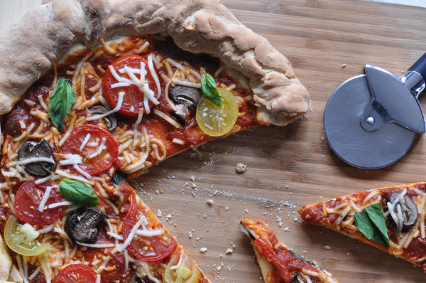 Gluten free Mediterranean pizza made with gfJules gluten free pizza crust mix