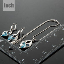 Load image into Gallery viewer, Blue Crystal Clip Earrings and Necklace Set - KHAISTA Fashion Jewellery