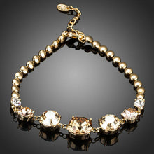 Load image into Gallery viewer, Gold Plated Cubic Zirconia Charm Bracelet - KHAISTA Fashion Jewellery