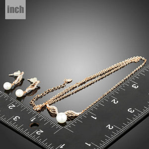 Rose Gold Angel Wings and Simulated Pearl Necklace and Earrings Set - KHAISTA Fashion Jewellery