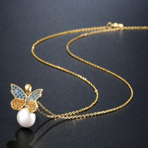 Sitting Golden Butterfly On Snow Pearl Necklace Pendant - KHAISTA Fashion Jewellery