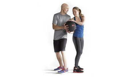 couple hands med ball back and forth to each other