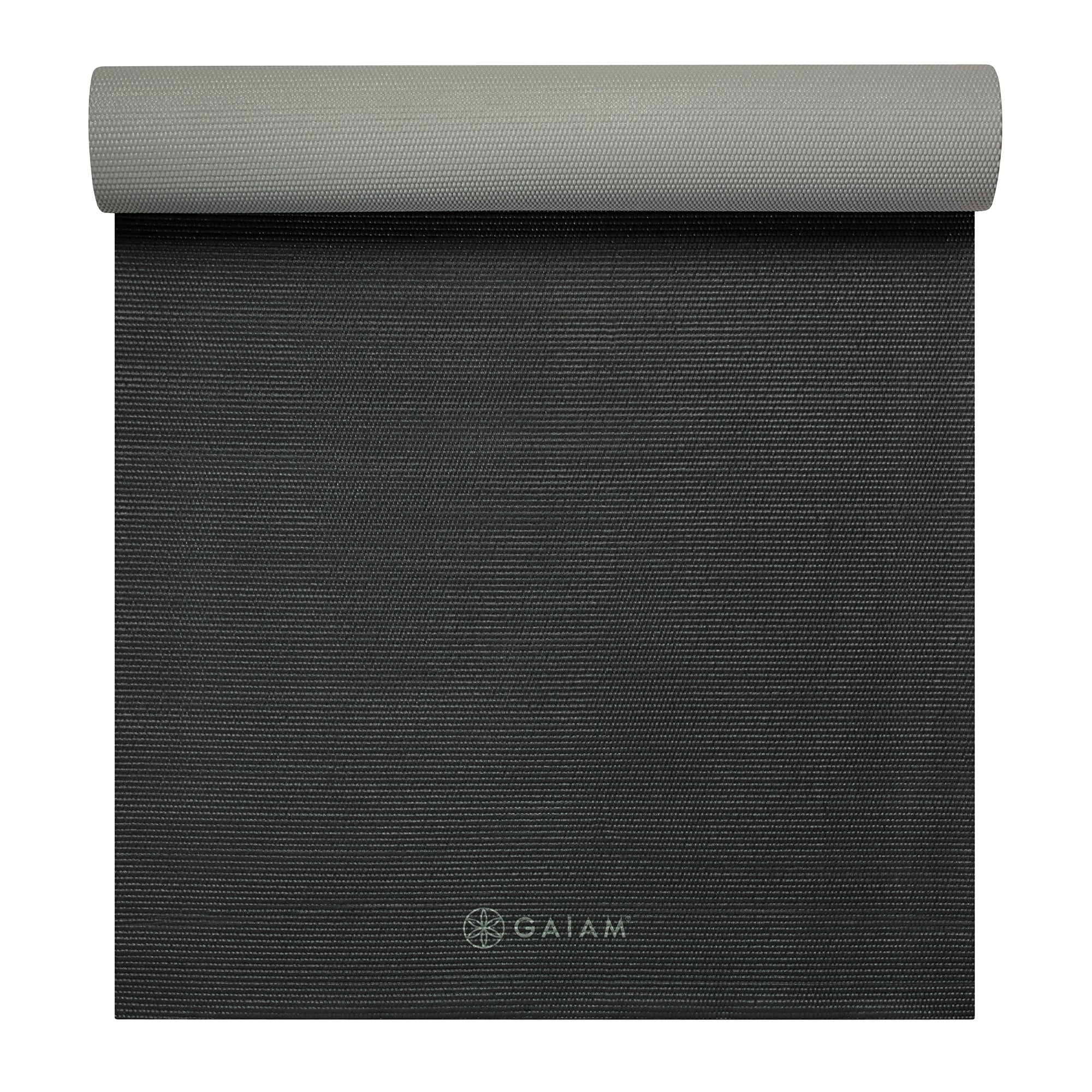 "This Athletic Yoga Mat from Gaiam is wider and longer than traditional mats to add more space and stability for those difficult extended poses. The extra-sticky 5mm surface will support you through even the most challenging of classes and exercises, while the reversible black and gray sides bring you versatility. 2"" wider and 10"" longer than standard mats No slip surface for any pose or practice Supportive 5mm thickness for joint protection Ideal for home, studio, or gym use Reversible, black or gray Made from long wearing and lightweight PVC 6P and latex free Measurements: 26"" wide x 78"" long x 5mm. Materials: PVC. Latex Free. 6P Free: Free of DEHP, DBO, BBO, DINP, DIDP, AND DNOP phthalates. Care Instructions: Yoga mats release a very strong but harmless odor when first unwrapped. Please unroll and air out your mat 2-3 before use. Spot clean with a damp cloth. Dry flat. The mat may fade or become brittle and unusable if exposed to the sun for extended periods of time. We recommend st"