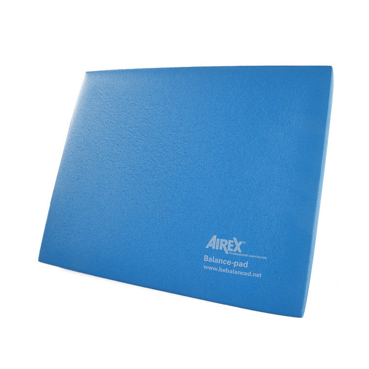"""The Airex® Balance Pad has a smooth surface, making it ideal for barefoot balance training. Due to the yielding foam, the body is constantly challenged to maintain balance and stabilize joints, improving your joint stability over time. This pad is also great for balance, mobility, standing stability and motor-skill training. Includes a free downloadable exercise guide. Airex® Balance Pad Features: Smooth surface Designed for barefoot balance training Improves joint stability Downloadable exercise guide Dimensions: Approximately 19.7""""L x 16.1""""W x 2.4""""H (6cm thick) Care instructions: Spot treat with a soft brush and warm soapy water. Air dry. Do not use solvents, stain remover, hot steam or water. Best stored flat. To avoid pressure, do not store any objects on top of them. Avoid storing in direct sunlight for long periods of time for the mat will become brittle and stiff over time. Airex® Balance Pad Exercise Guide"""
