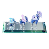 Glass Baron Elephant Train Figurine with Airbrushed Amethyst, Rose and Sapphire Colored Ears Mounted On Mirrored Glass Base