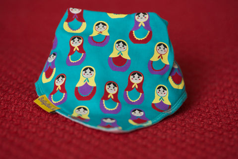 Bandana Bib in Turquoise with Pretty Little Russian Dolls FRONT