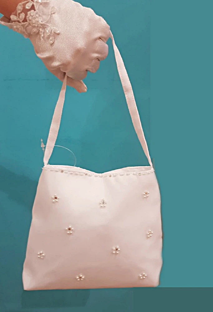 Girls Communion bag - White satin Communion bag with a diamante centre with pearls forming a flower structure that is scattered throughout. The opening of the bag has a row of beads following the opening outline and is complete with a satin handle and a clear snap closure located inside.