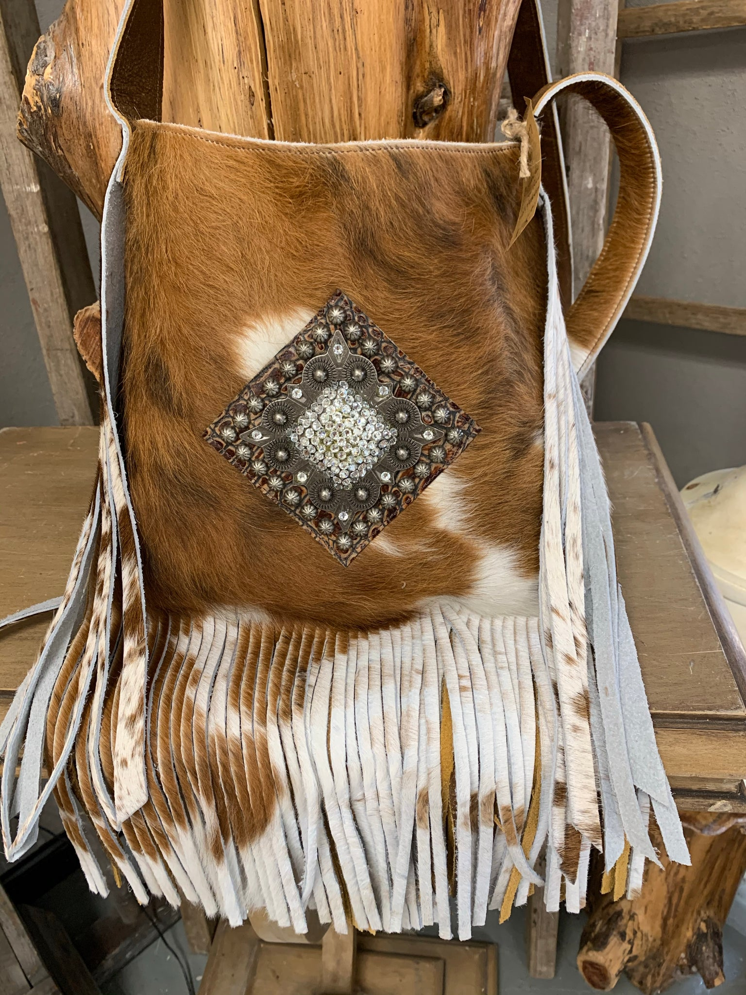 Raviani Fringe GoldenBrown and White Cowhide Shoulder Bag with Diamond Medallion