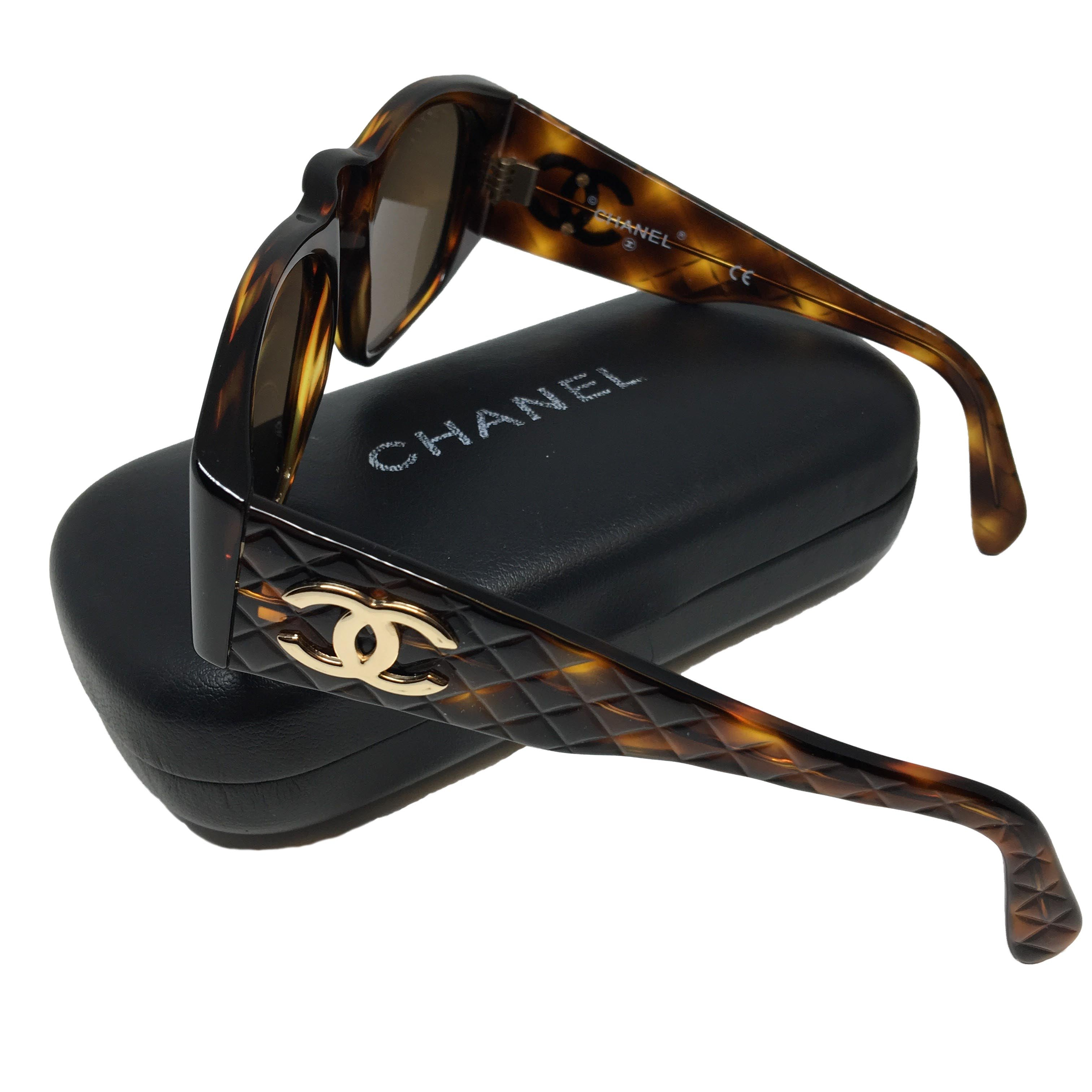 cc3d959b0159 CHANEL tortoise shell sunglasses with CC logo on quilted arms - The ...